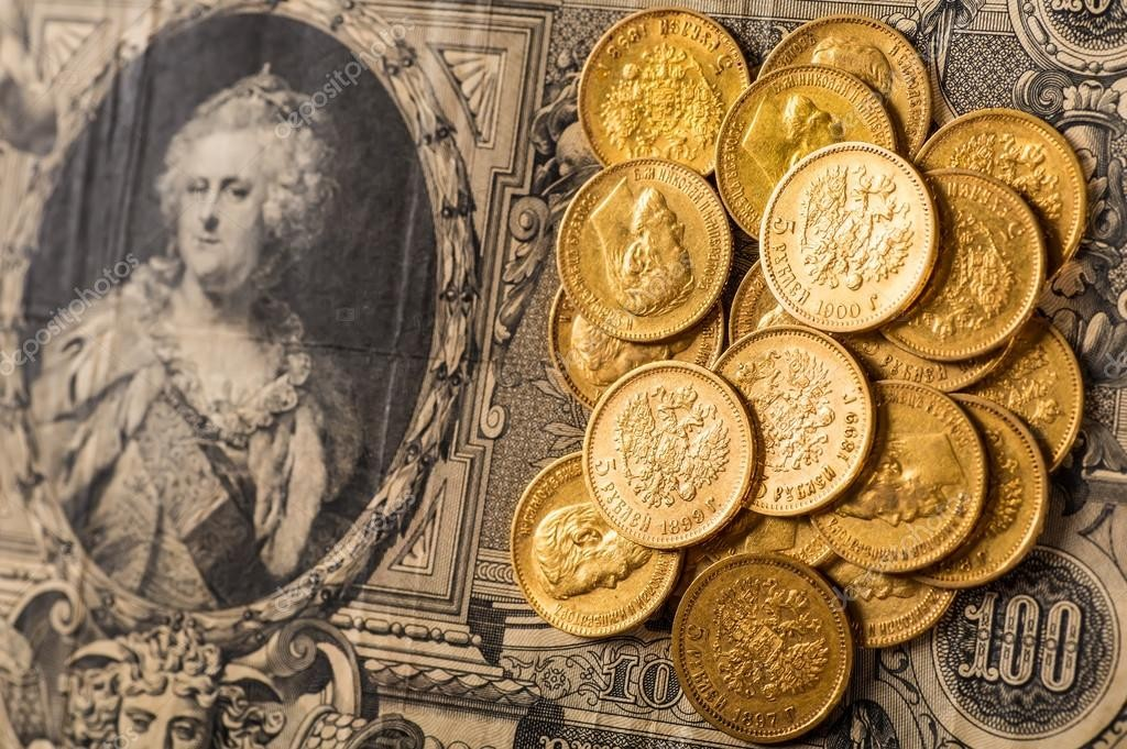 depositphotos_104149670-stock-photo-gold-and-silver-coins-of